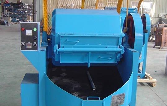 Rotary metal parts tumbler