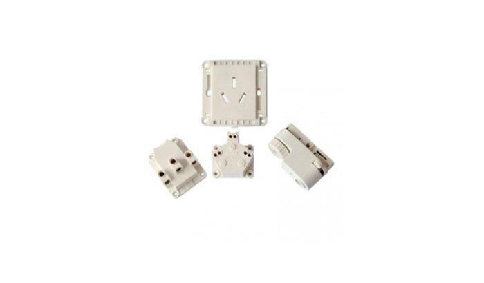 Deflashing plastic electronic parts